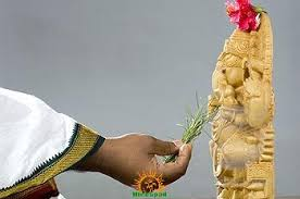 Ganesh idol and durva grass
